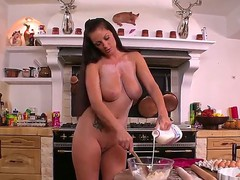 Dark haired tattooed bombshell Sheila Grant with big ass and huge juicy gazongas in high heels and apron only gets nasty in the kitchen and covers her body with food.