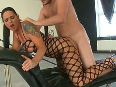 Sinful chick Simony Diamond stays in black fishnet suit before starting to have fun with her boyfriend. She gives a head to him before getting ass dildoed and fucked.