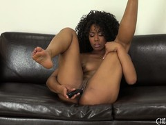 Misty Stone likes playing solo on the cool leather couch with her hot cunt