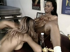Two creamy dark-skinned lesbians play with whipped cream and chocolate